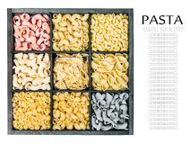 Pasta assortment background. Isolated on white background. Pasta in a wooden box. Italian pasta of different colors. text removed Stock Images