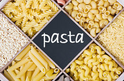 Pasta assortment and blackboard for text Royalty Free Stock Photo