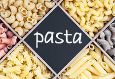 Pasta assortment and blackboard with text Stock Photo