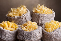 Pasta assortment in burlap bags Royalty Free Stock Image