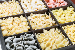 Pasta assortment of different colors. Background Royalty Free Stock Photo