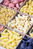 Pasta assortment of different colors background Royalty Free Stock Photo
