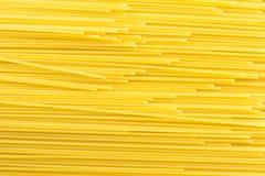 Pasta background. Spaghetti background made of raw pasta Stock Photo