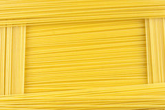 Pasta background. Spaghetti background made of raw pasta Royalty Free Stock Image