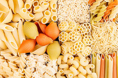 Pasta background assortment of different kinds italian macaroni in chess cells top view. Healthy traditional food backdrop Royalty Free Stock Photos