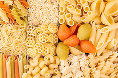 Pasta background assortment of different kinds italian macaroni in chess cells top view. Healthy traditional food backdrop Stock Photography