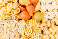 Pasta background assortment of different kinds italian macaroni in chess cells top view. Healthy traditional food backdrop Royalty Free Stock Photography