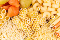 Pasta background assortment of different kinds italian macaroni in chess cells top view. Healthy traditional food backdrop Stock Image