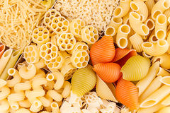 Pasta background assortment of different kinds italian macaroni in chess cells top view. Healthy traditional food backdrop Royalty Free Stock Photo