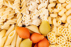 Pasta background assortment of different kinds italian macaroni in chess cells top view. Healthy traditional food backdrop Stock Photo
