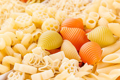 Pasta background assortment of different kinds italian macaroni closeup. Healthy traditional food backdrop Royalty Free Stock Photos