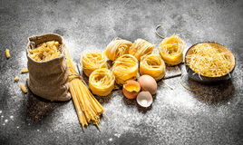 Pasta background. Cooking different types of pasta. Royalty Free Stock Image