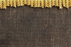 Pasta on background. Crude pasta on wooden background Royalty Free Stock Photography