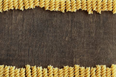 Pasta on background. Crude pasta on wooden background Royalty Free Stock Image