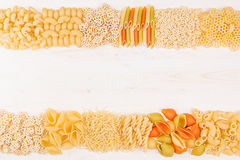 Pasta background decorative border of assortment different kinds italian macaroni. Royalty Free Stock Photo