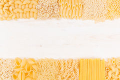 Pasta background decorative border of assortment different kinds italian macaroni. Healthy traditional food backdrop Stock Photo