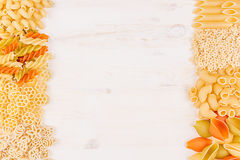 Pasta background decorative border of assortment different kinds italian macaroni. Healthy traditional food backdrop Royalty Free Stock Image