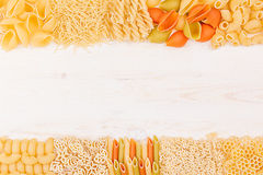 Pasta background decorative border of assortment different kinds italian macaroni. Healthy traditional food backdrop Stock Images
