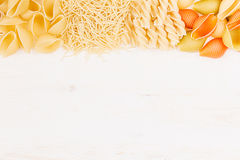 Pasta background decorative border of assortment different kinds italian macaroni. Healthy traditional food backdrop Royalty Free Stock Images