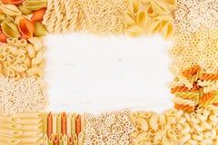 Pasta background decorative frame of assortment different kinds italian macaroni. Mock up restaurant menu Stock Images