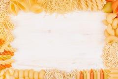 Pasta background decorative frame of assortment different kinds italian macaroni. Mock up restaurant menu Royalty Free Stock Photos