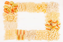Pasta background decorative frame of assortment different kinds italian macaroni. Mock up restaurant menu Royalty Free Stock Image