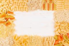 Pasta background decorative frame of assortment different kinds italian macaroni. Mock up restaurant menu Stock Photo