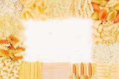 Pasta background decorative frame of assortment different kinds italian macaroni. Mock up restaurant menu Royalty Free Stock Photography