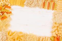 Pasta background decorative frame of assortment different kinds italian macaroni. Mock up restaurant menu. Pasta background decorative frame assortment Stock Image