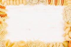Pasta background decorative frame of assortment different kinds italian macaroni. Mock up restaurant menu Stock Photography