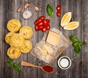 Pasta background frame with ingredients for cooking on weathered Stock Photos