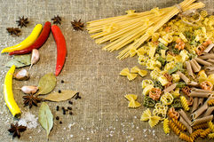 Pasta background. Free space for text .Rigatoni, fusilli, vermicelli, creste. Pasta background. Free space for text . Rigatoni, fusilli, vermicelli, creste Royalty Free Stock Image