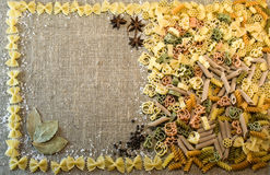 Pasta background. Free space for text .Rigatoni, fusilli, vermicelli, creste. Pasta background. Free space for text . Rigatoni, fusilli, vermicelli, creste Stock Photo