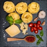 Pasta background with ingredients for cooking on slate board, to Royalty Free Stock Photography