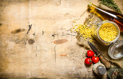 Pasta background. Pasta with olive oil, tomatoes and salt. Royalty Free Stock Image