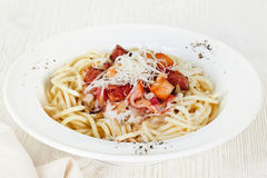 Pasta with bacon and chicken plate white background menu cheese carbonara Stock Images