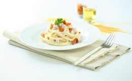 Pasta with bacon and cream sauce Stock Images