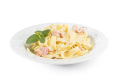 Pasta with bacon. Parmesan cheese and decorated with a sprig of mint Royalty Free Stock Images