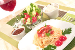 Pasta, bacon with salad and glass of wine. Royalty Free Stock Photos