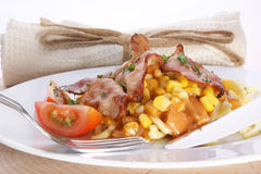 Pasta with bacon and sweet corn tomato sauce Royalty Free Stock Photos