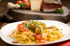 Pasta with bacon and tomatoes Royalty Free Stock Photo