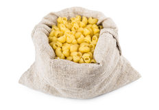 Pasta in bag of coarse cloth isolated on white Stock Photos