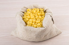 Pasta in bag of coarse cloth Royalty Free Stock Photography