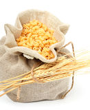 Pasta in bag with wheat ears. Isolated on white Royalty Free Stock Images
