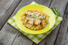 Pasta bake with broccoli and chicken. On a wooden table Royalty Free Stock Photography