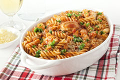 Pasta Bake with Chicken. Fusili or spiral pasta, baked with chicken and marinara, topped with green chilli and parmesan Stock Photos