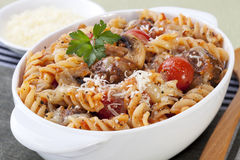 Pasta Bake with Meatballs. Mushrooms and cherry tomatoes, in tomato sauce, with melting mozzarella Royalty Free Stock Photos