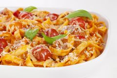 Pasta Bake with Meatballs and Tagliatelle. Pasta bake with meatballs, cherry tomatoes, tagliatelle, mozzarella, parmesan and basil royalty free stock images
