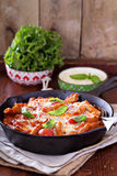 Pasta bake with penne, tomatoes and mozarella Royalty Free Stock Image