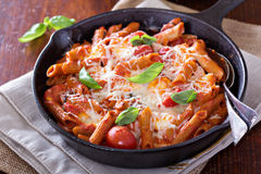 Pasta bake with penne, tomatoes and mozarella Stock Photos